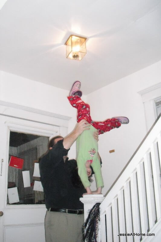 Daddy-helping-Vada-handstand
