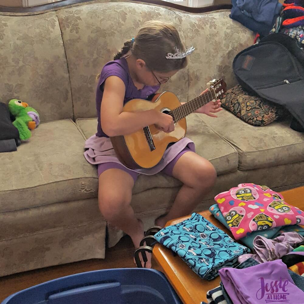 Kyla playing her new guitar