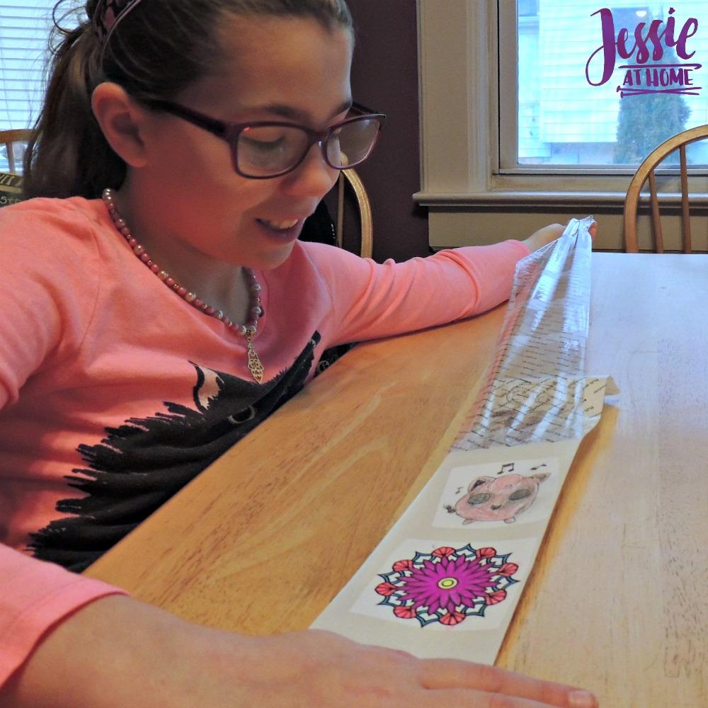 Kyla peeling the stickers