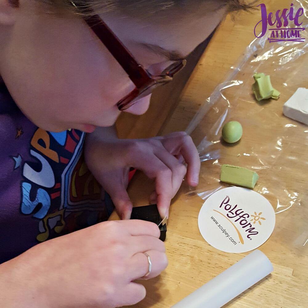 Kyla Cutting her Sculpey