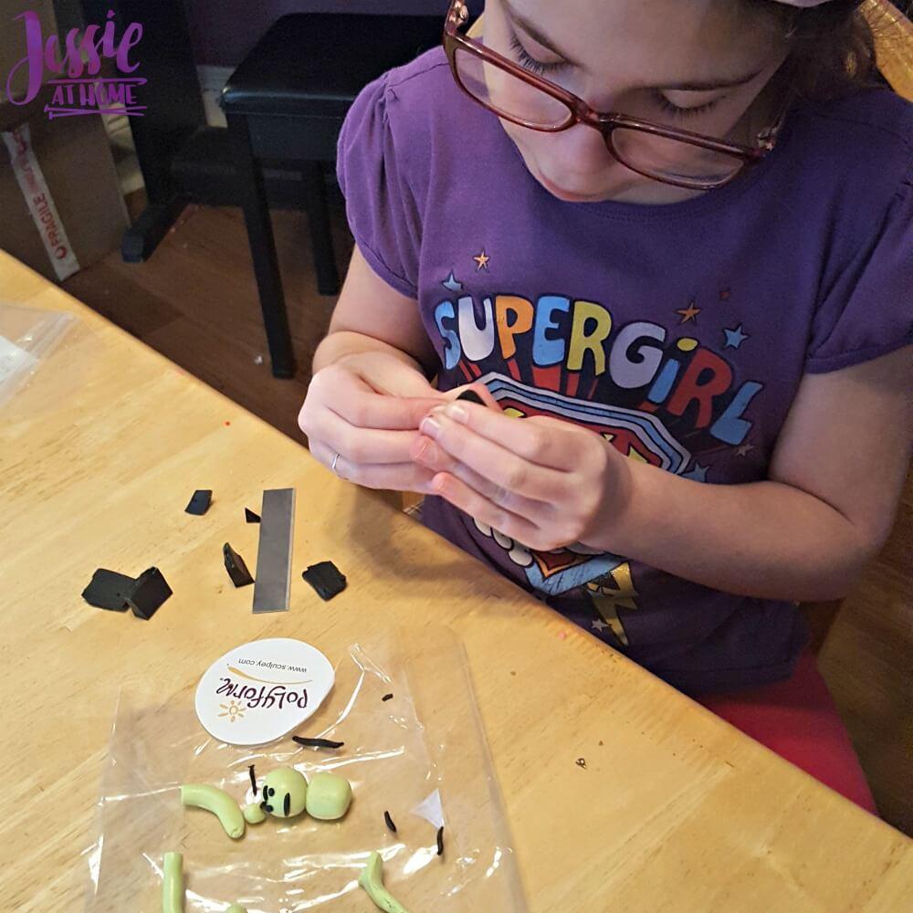 Kyla making a Sculpey Hulk