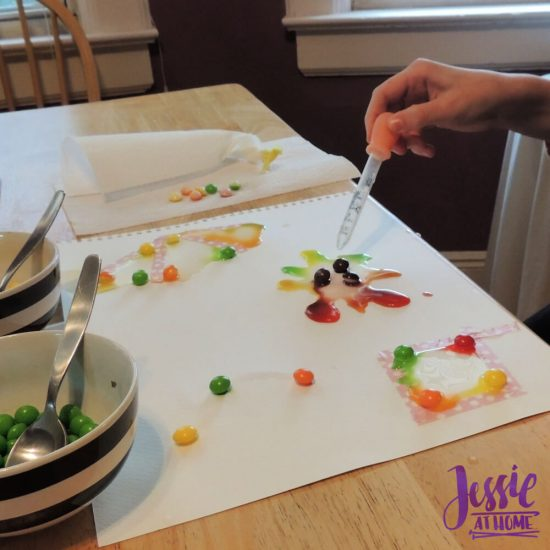Painting with Skittles craft tutorial by Jessie At Home - Vada dropping