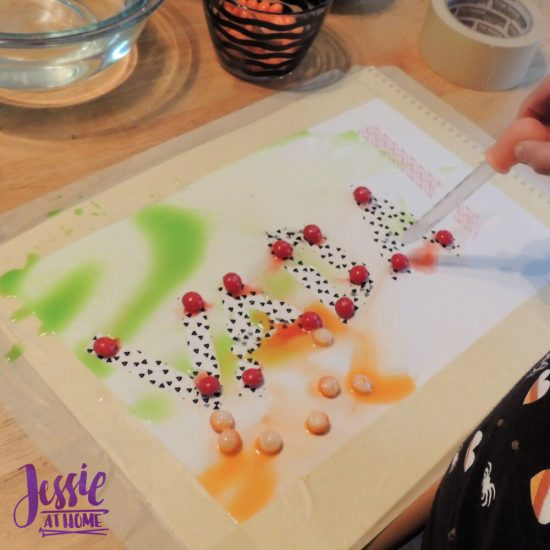 Painting with Skittles craft tutorial by Jessie At Home - Vada in process