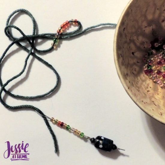 Crochet Necklace with Pendant and Beads by Jessie At Home - stringing beads